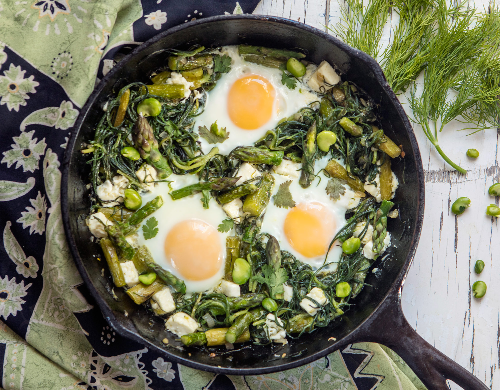 Eggs with agretti, asparagus and feta